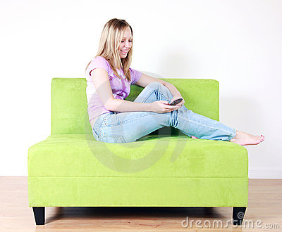 Teen girl texting on couch