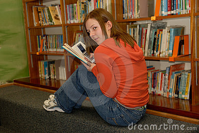 Teen Girl Texting in Library