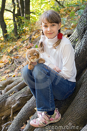 Teen girl with toy tiger