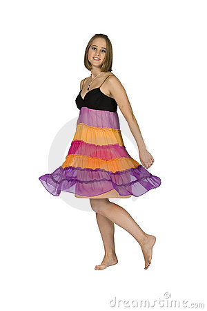 Teen Girl Twirling In Colorful Dress - Isolated
