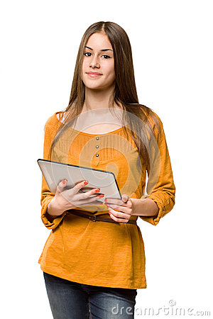 Teen girl using tablet computer.