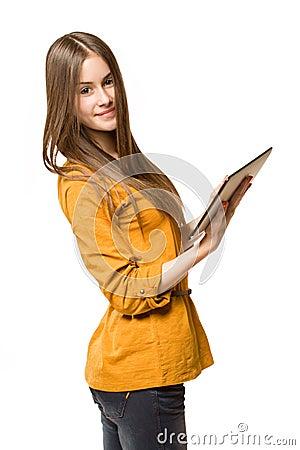 Teen girl using tablet computer.