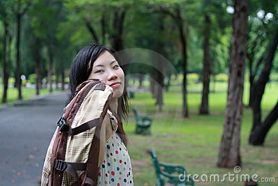 Teen girl walking in the park