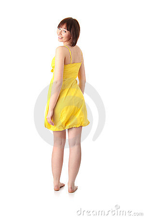 Teen girl in yellow summer dress