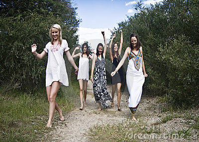 Teen girls on dirt path