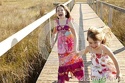 Teen girls running outdoor at the park