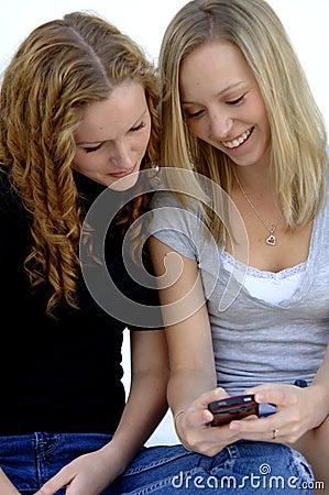 Teen girls sending text message