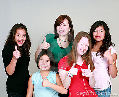 Teen girls with thumbs up