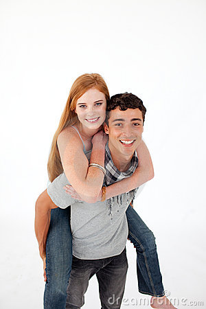 Teen giving his girlfriend piggyback ride
