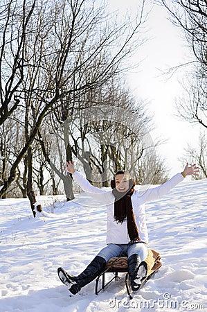 Teen having fun on sledge