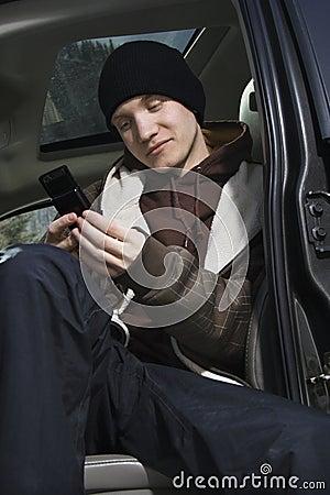 Teen holding cellphone.