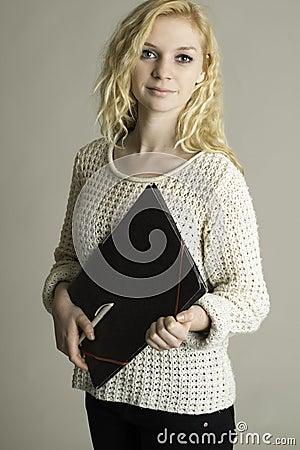 Teen holding folder