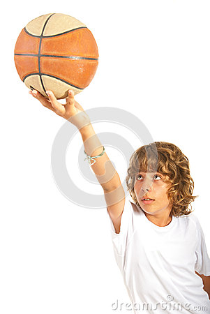 Teen holding up basketball