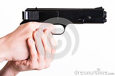 Teen holds a handgun