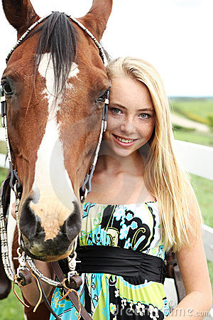 Teen and horse head shot