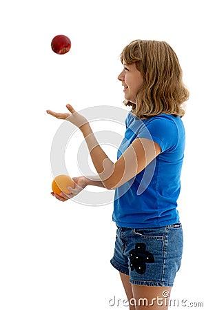 Teen Juggling Apple and Orange