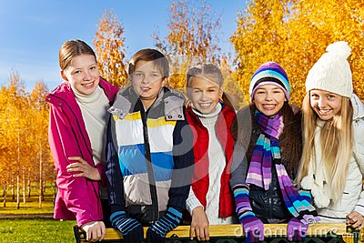 Teen kids in autumn park