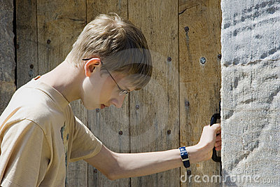 Teen knocking at an old door