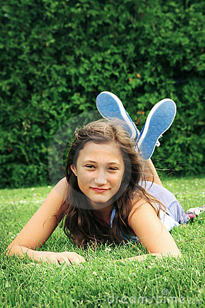 Teen laying in a grass