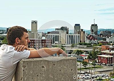 Teen looking at city