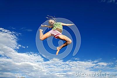 Teen in mid-jump