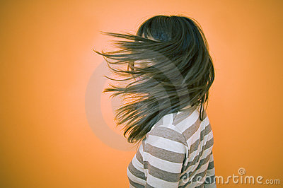 Teen Obscured By Blowing Hair