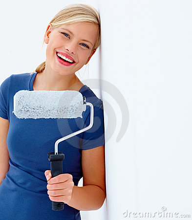 teen with paint roller isolated on white