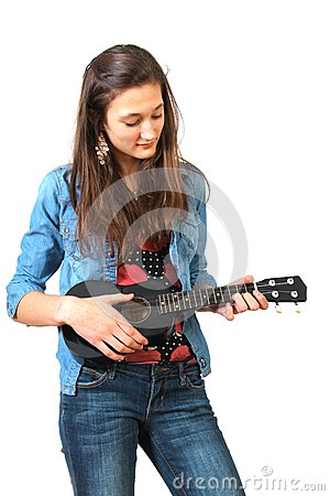 Teen playing ukulele