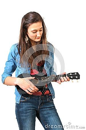 Teen playing ukulele