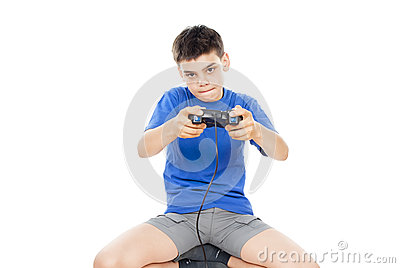 Teen plays on the joysticks lying on the floor