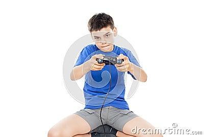 Teen plays on the joysticks lying on the floor