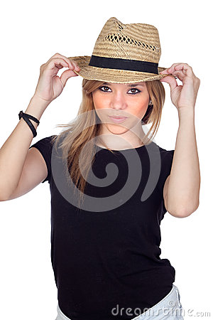 Teen rebellious girl with a straw cap