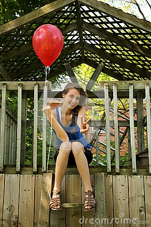 Teen with red balloon