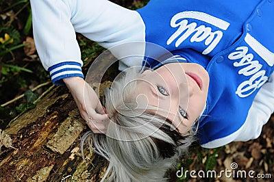 Teen resting on tree