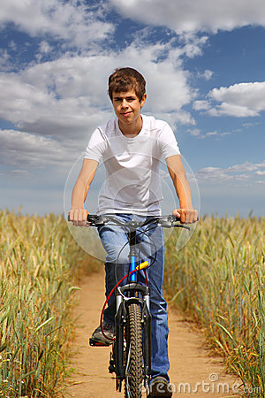 Teen riding a bicycle