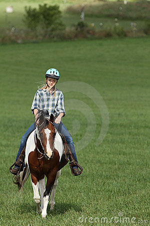 Teen riding her horse
