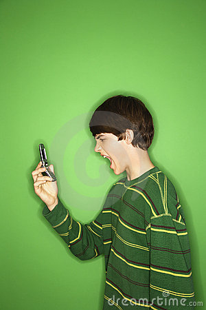 Teen screaming at cellphone.