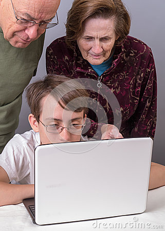Teen Showing Grandparents How to Use Computer