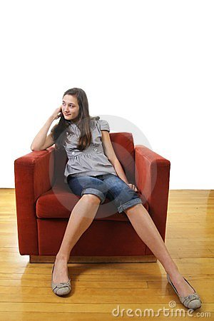 Teen sit in a sofa
