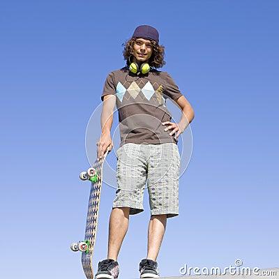 Teen skater atop ramp