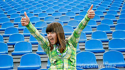 Teen at the stadium with okay
