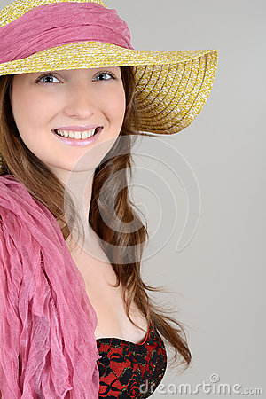 Teen with straw hat and pink scarf