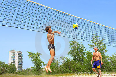 Teen Strikes Ball Into Net Royalty Free Stock Photography - Image: 2700457