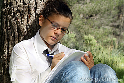 teen studying writing
