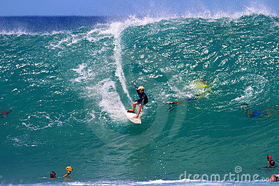 Teen Surf Boy, Surfing a Big Wave in Hawaii Editorial Image