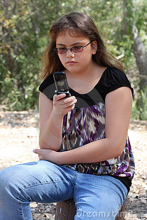 Teen texting on cell phone