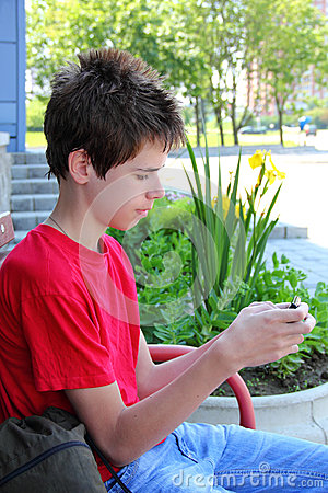 Teen typing a text message