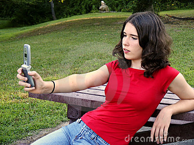 Teen using camera phone
