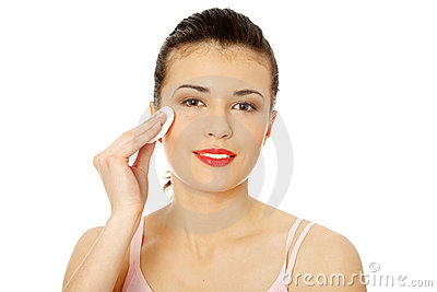 Teen using a cotton pad to remove her make-up