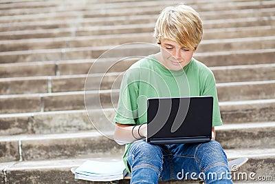 Teen using laptop